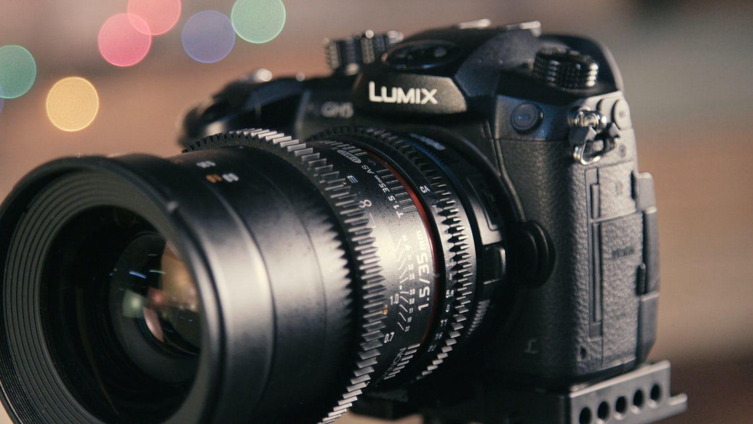 A close up of a camera panasonic lumix gh5 camera and videocamera