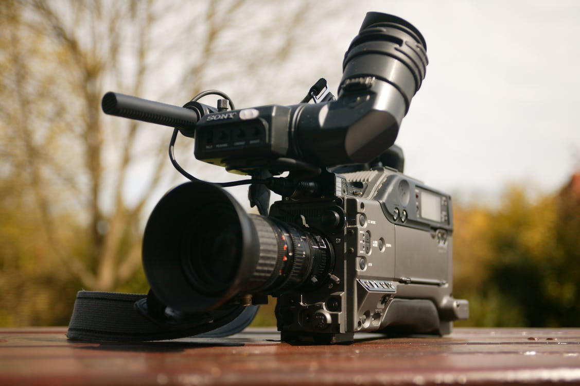 Sony pxw-fs7 video camera with microphone on a table in the nature