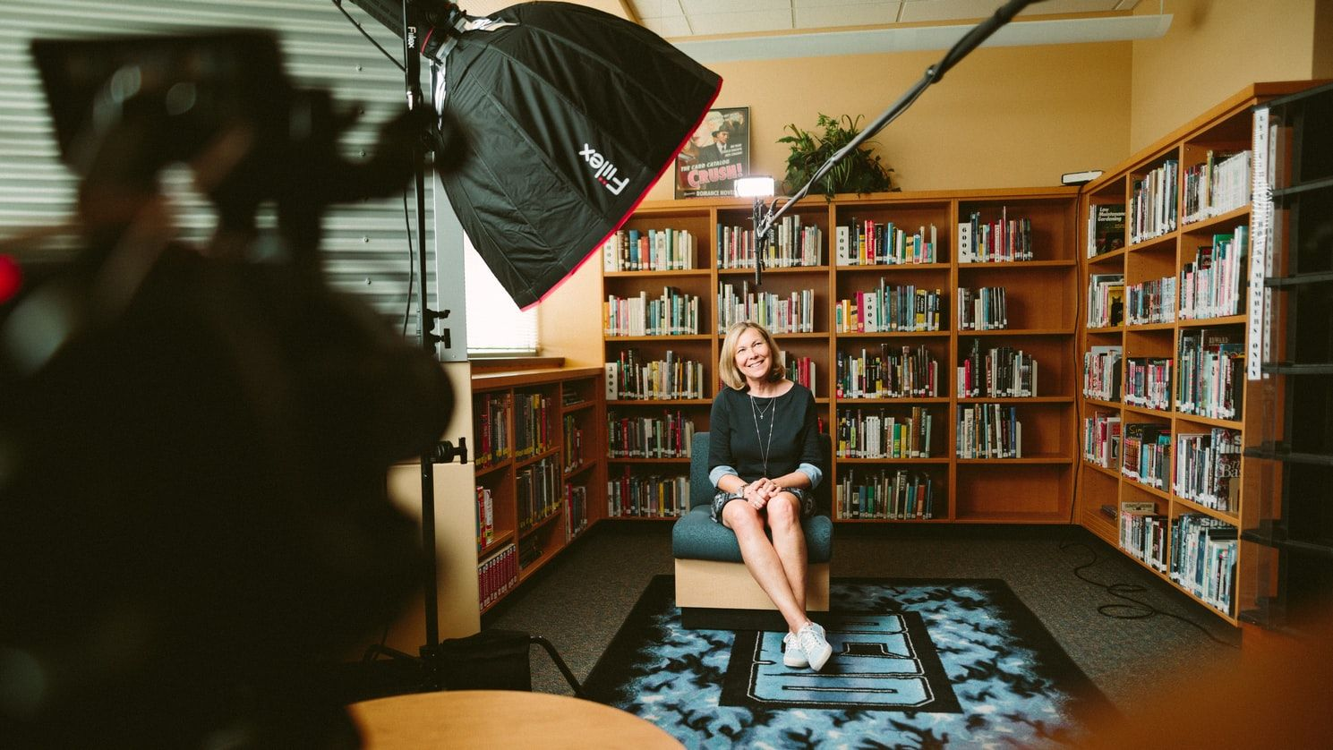 documentary filmmaking woman sitting in the library being interviewed