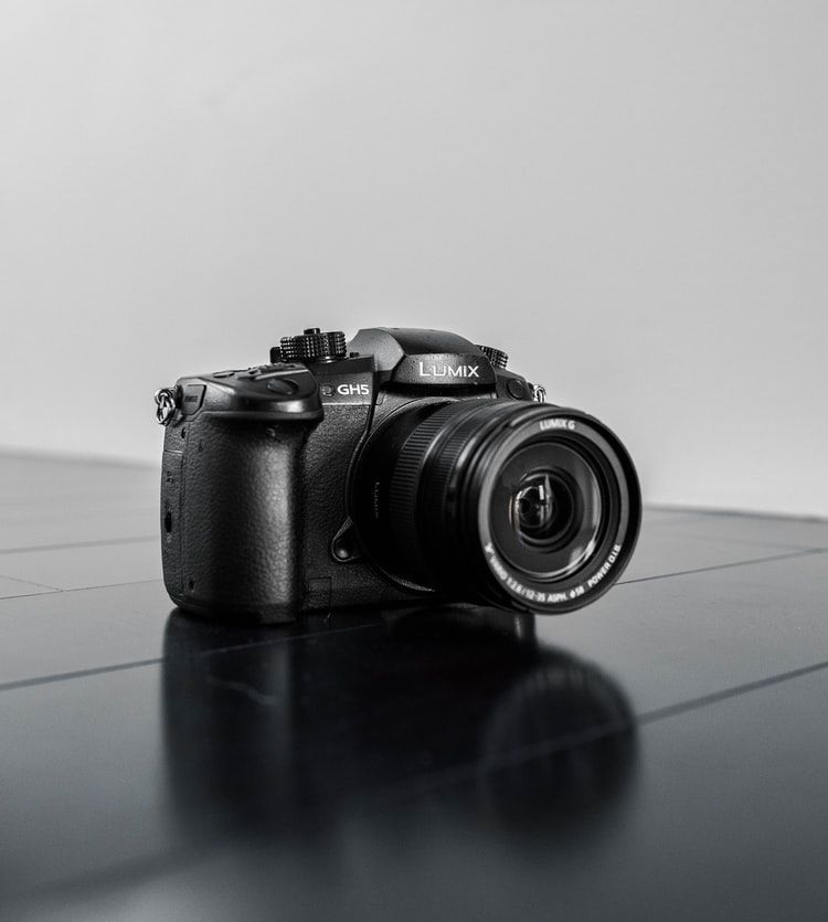 Panasonic Lumix GH5 camera on the black table