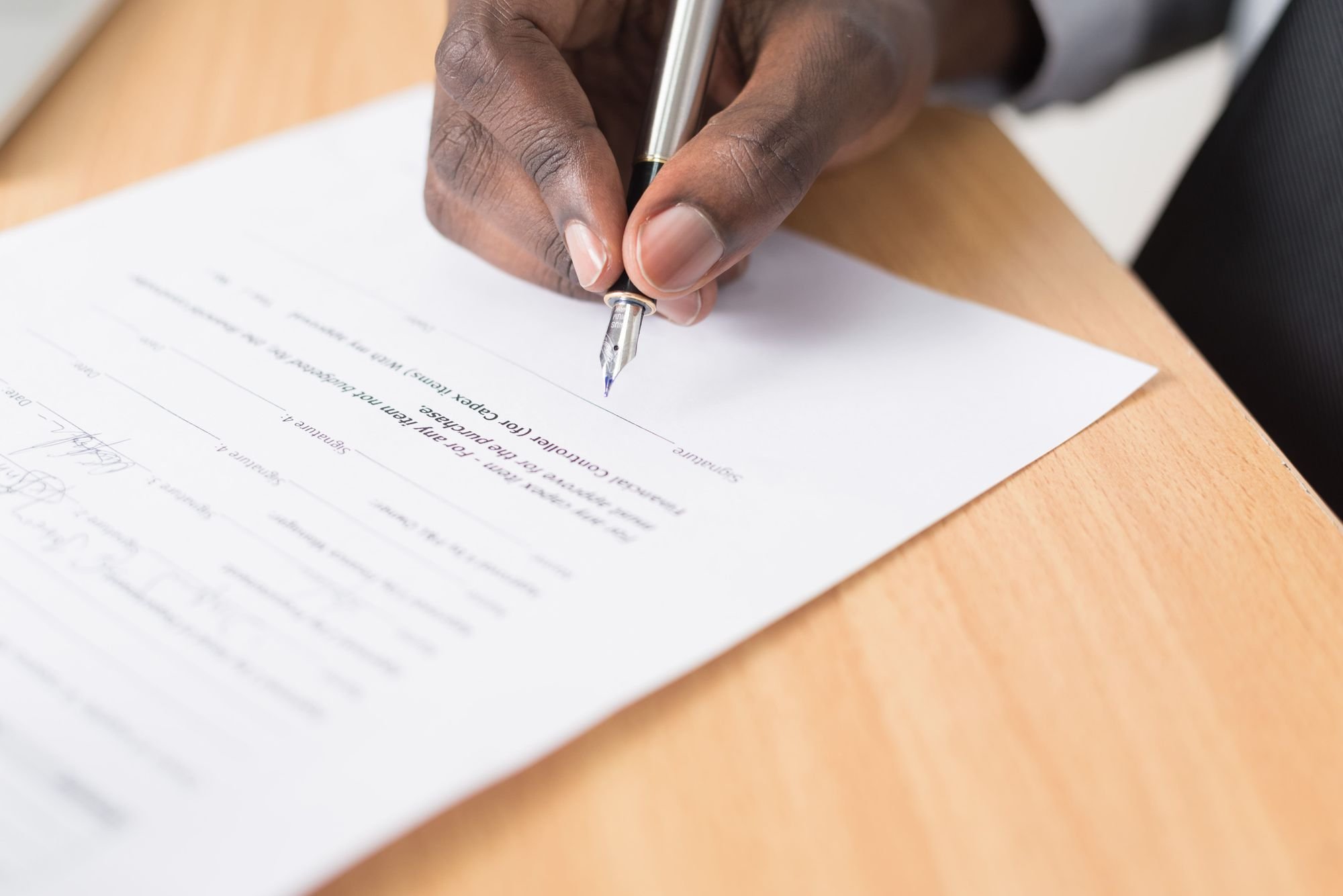 person-signing-business-contract-for-their-company