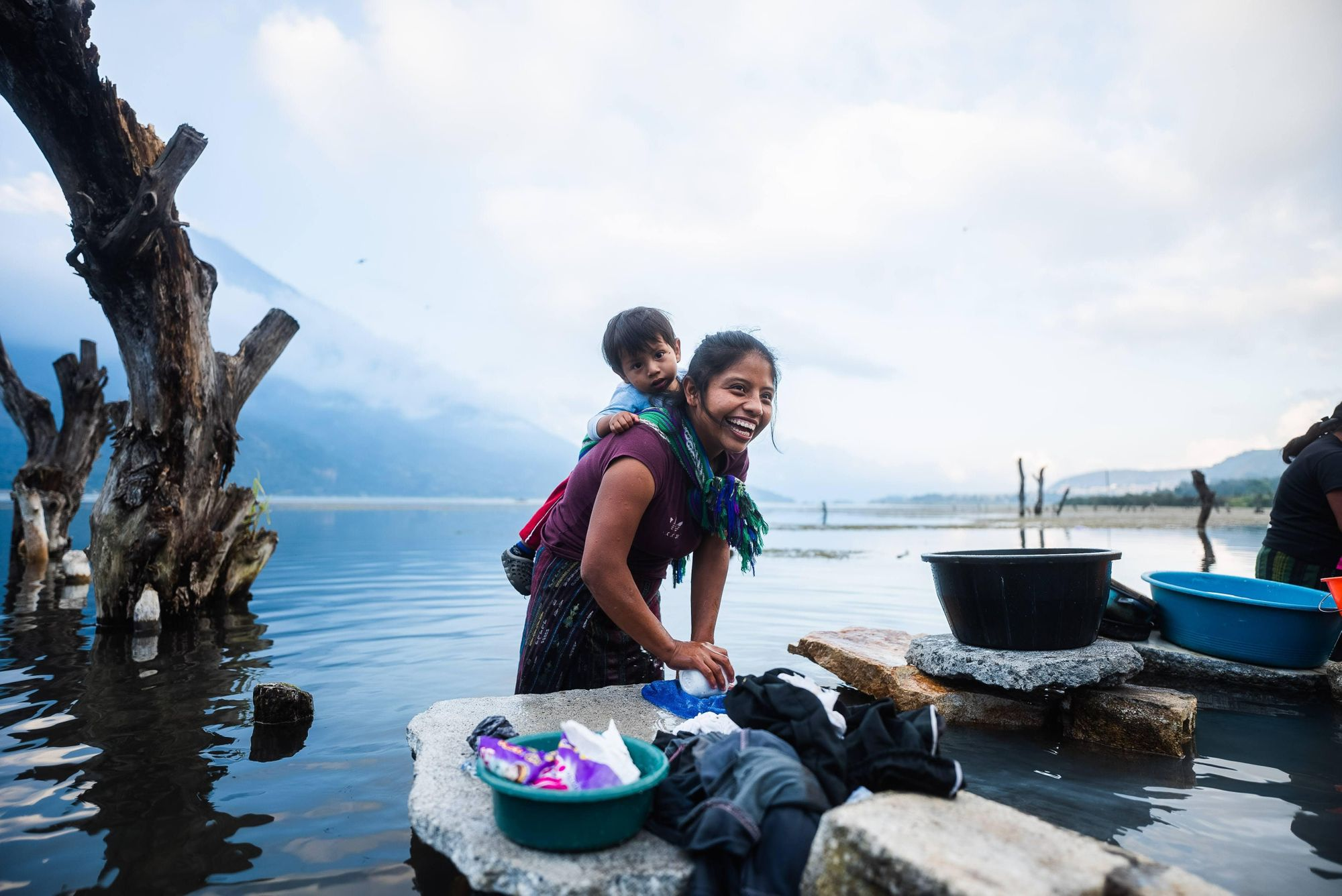 woman-with-child-working-at-shore