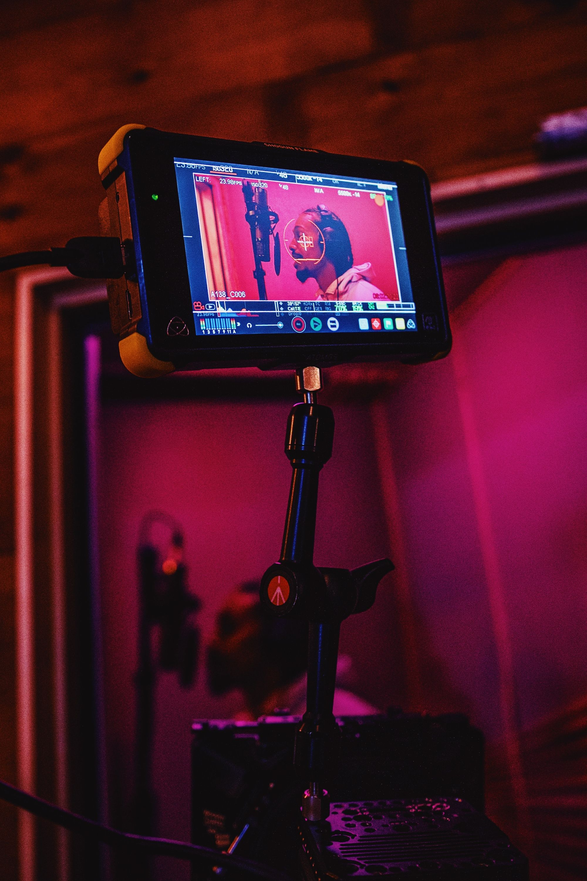 camera-filming-artist-singing-into-microphone