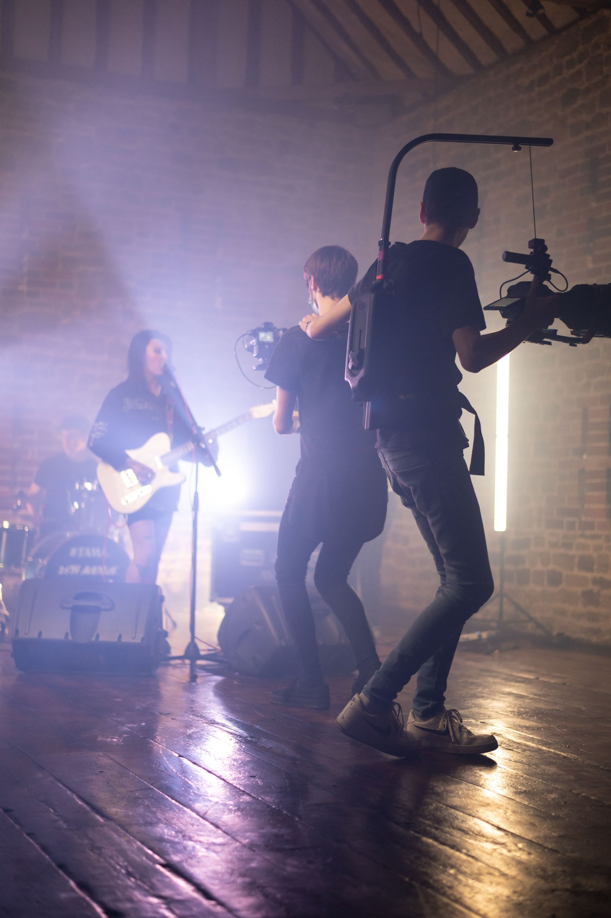 music-video-production-team-filming-band-playing-music