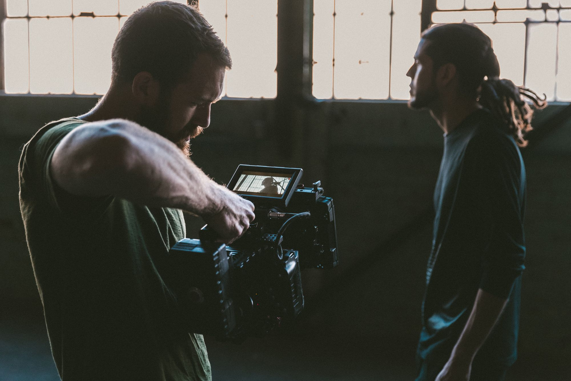 camera-man-filming-guy-in-building