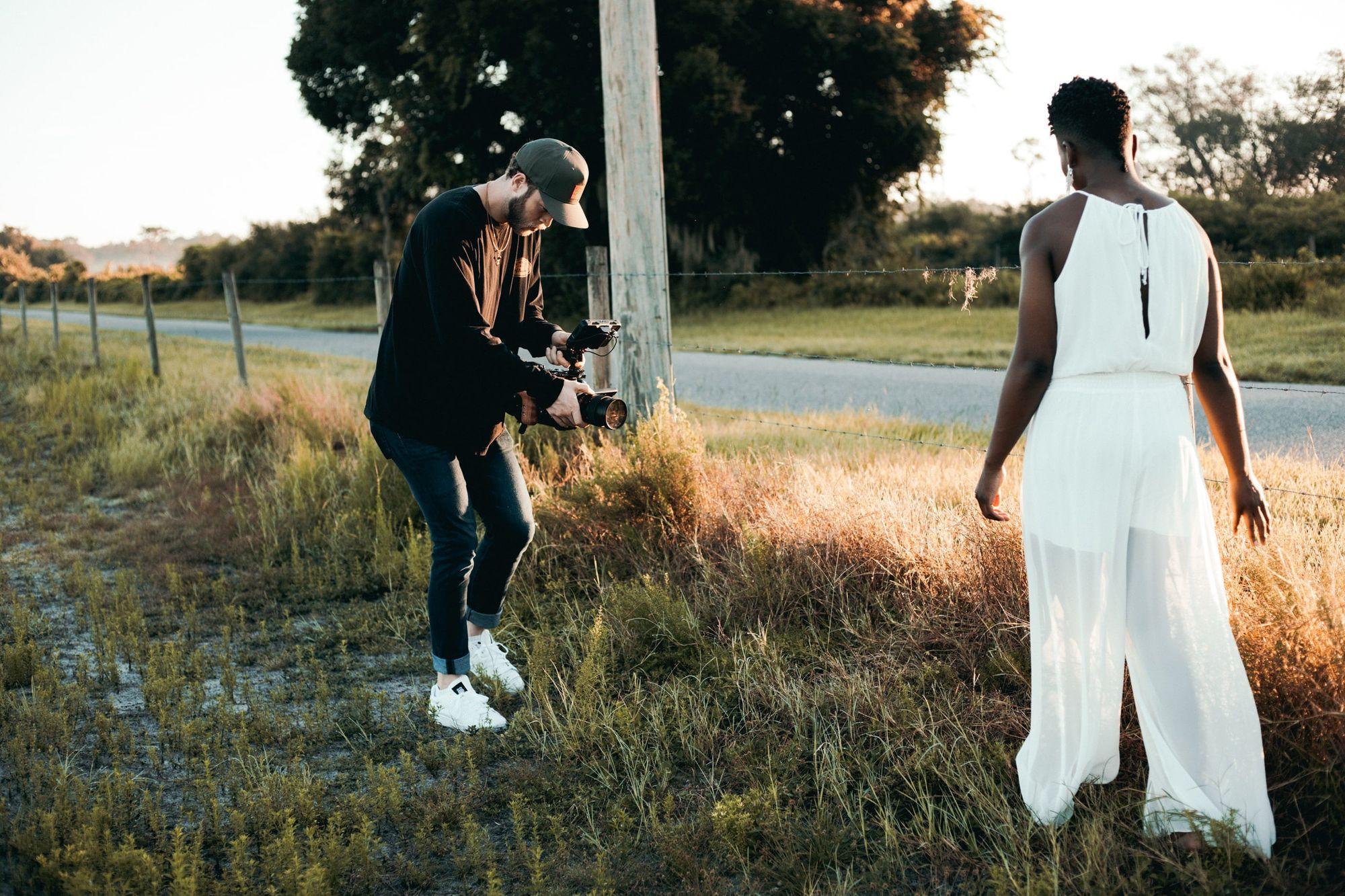 fashion-videographer-filming-woman-in-white-dress