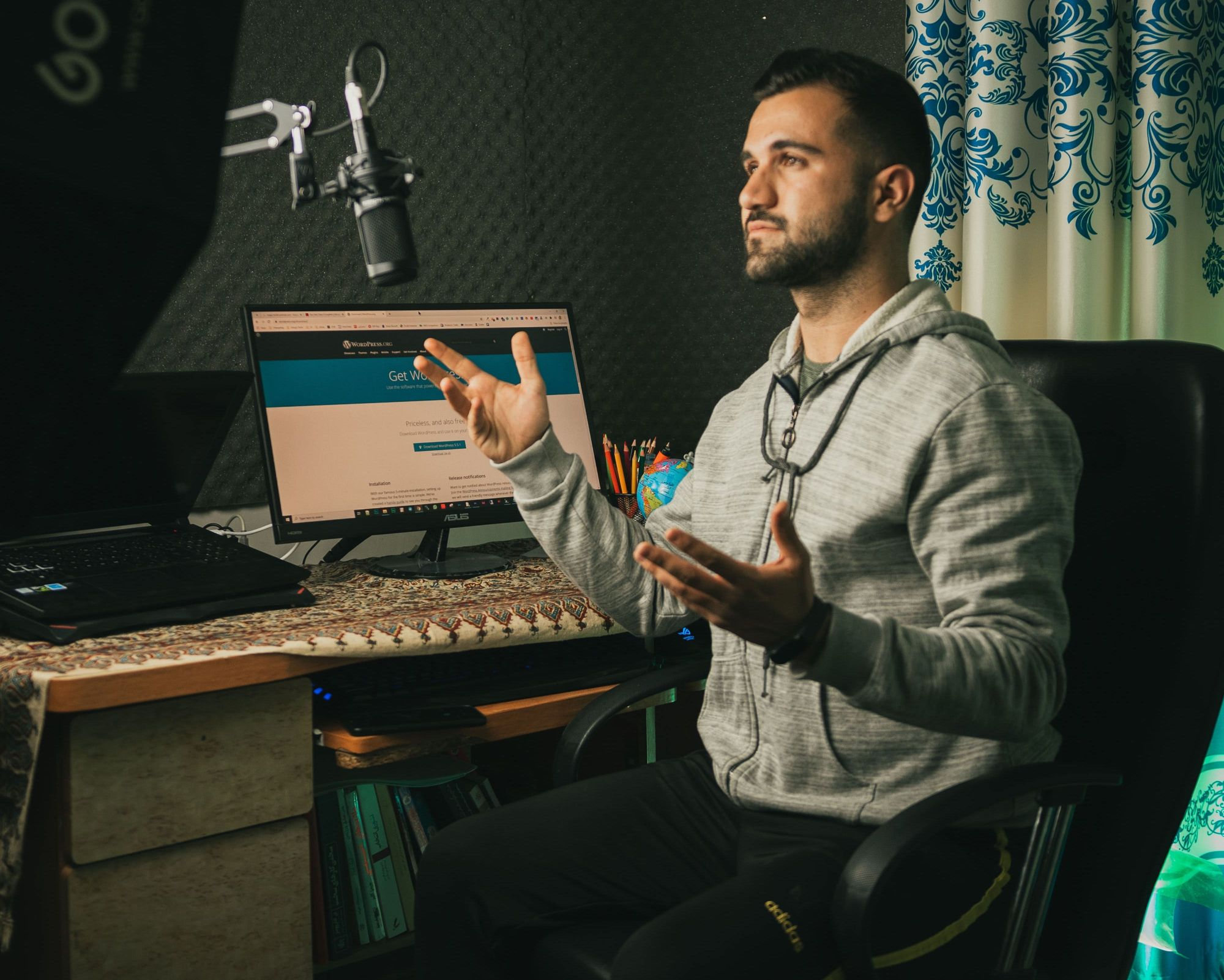 man-at-computer-with-microphone