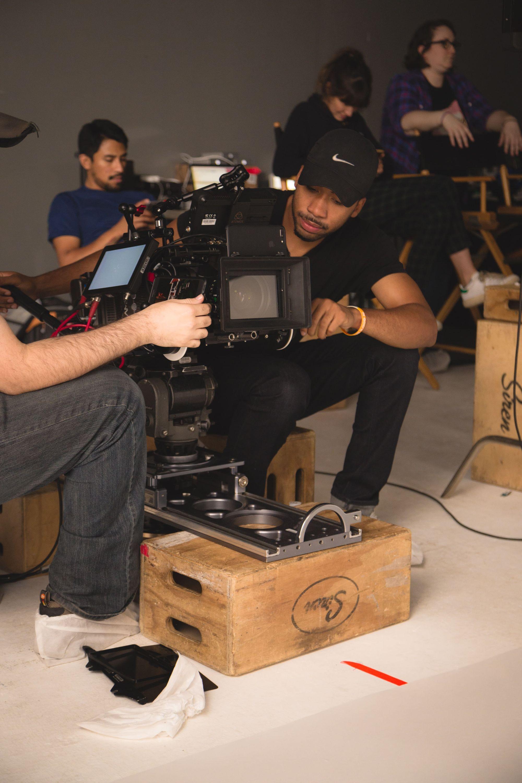 man-holding-camera-while-making-film