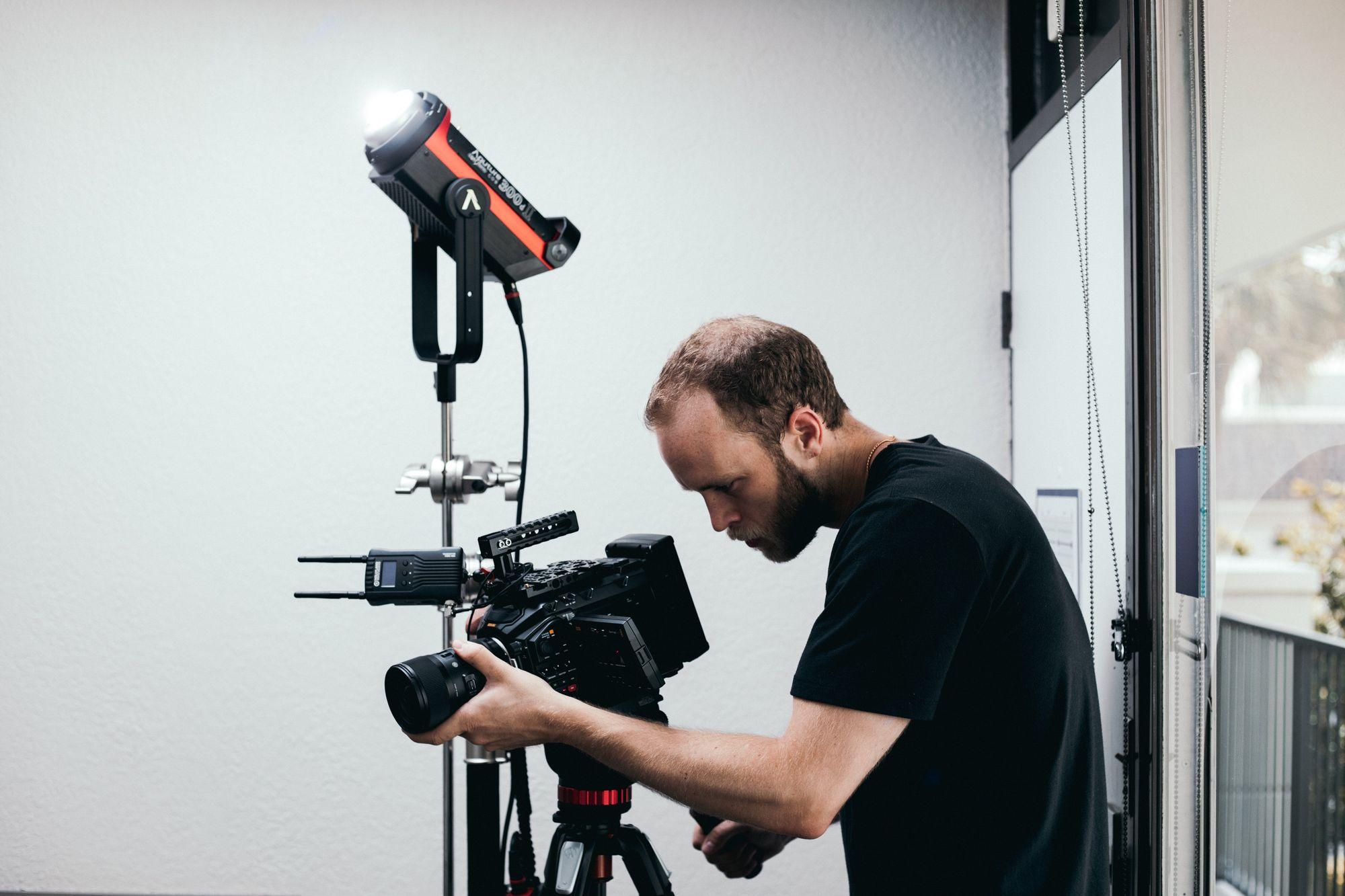 man-checking-camera-equipment