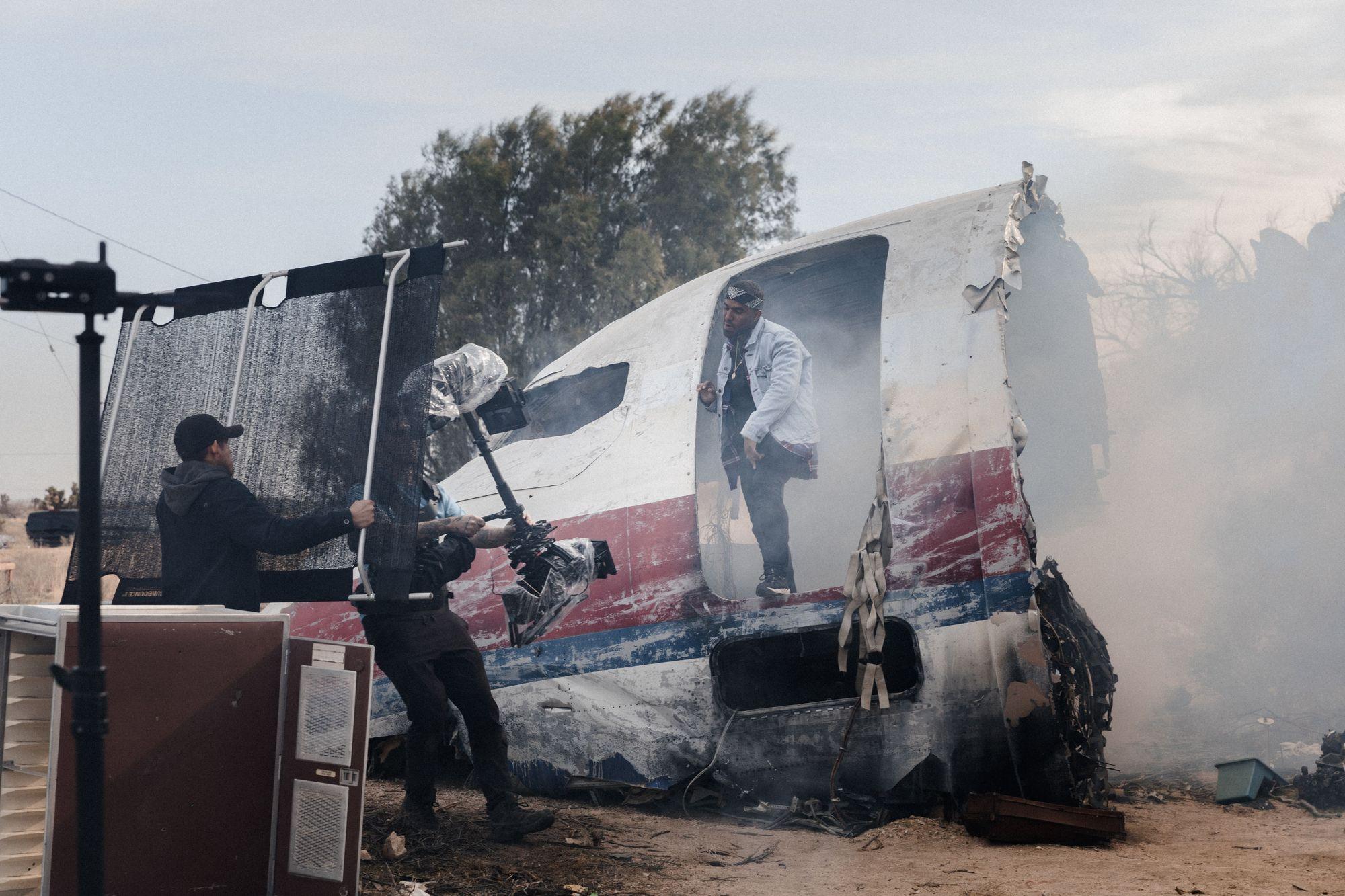 Creative music video shoot on a broken airplane