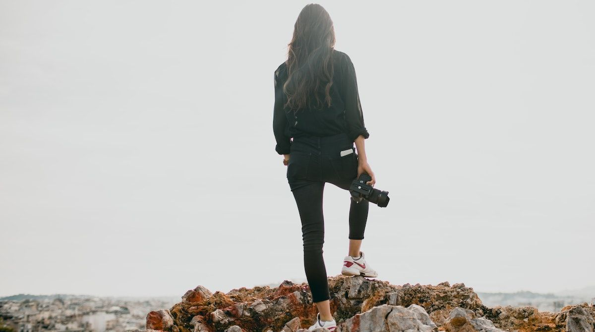 photographer standing on a cliff
