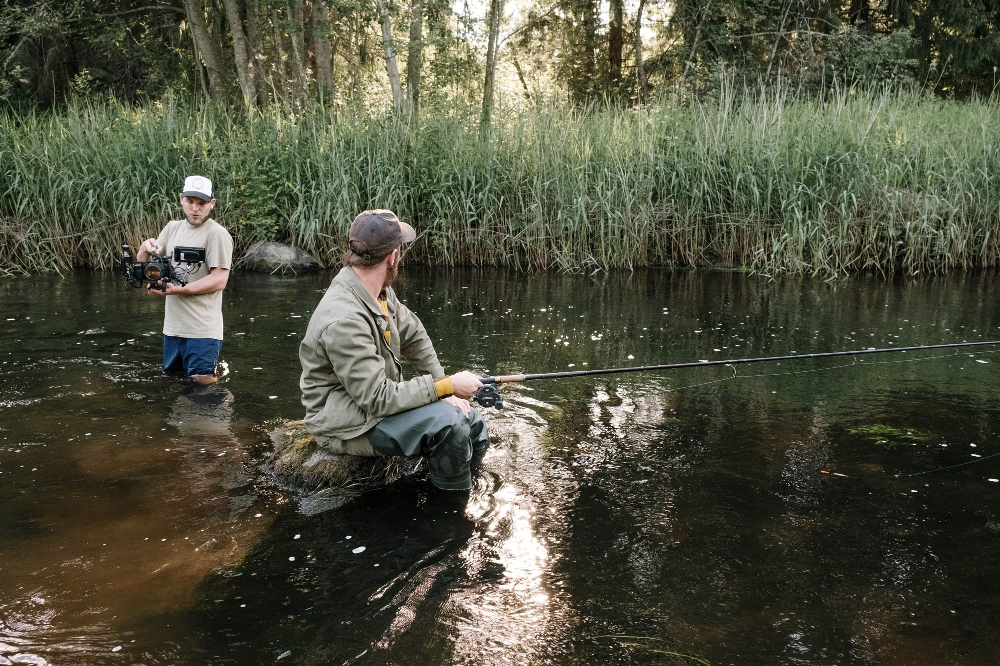 filming guy fishing